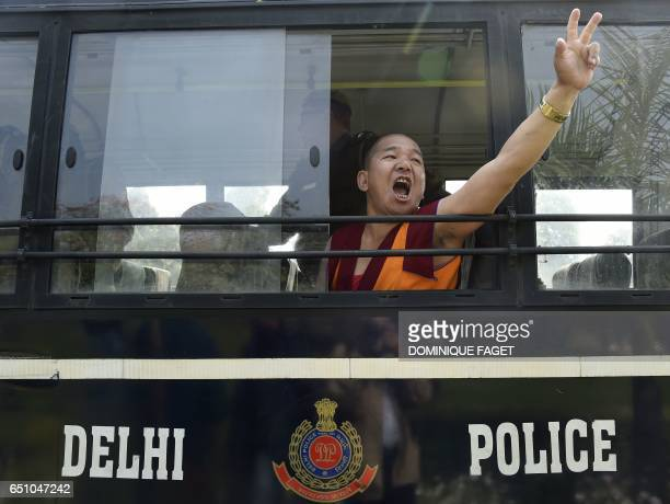 A Tibetan exile activist shouts slogans after being detained during a protest outside the Chinese embassy in New Delhi on March 10 2017 Tibetan...