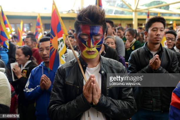 Tibetan exiles pray as they mark the 57th anniversary of the 1959 uprising against Chinese rule in McLeod Ganj on March 10 2016 Beijing says its...