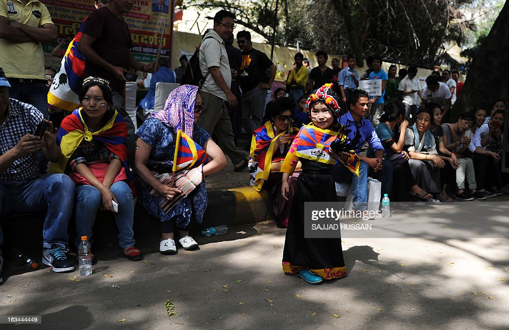 Tibetan exiles residing in India take a break during a protest rally in New Delhi on March 10, 2013. The protest marked the 54th anniversary of the Tibetan national uprising, the 1959 rebellion against China's rule in Tibet. AFP PHOTO/ Sajjad Hussain