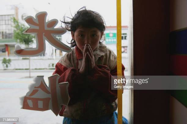 Tibetan girl begs for food outside a restaurant on June 24 2006 in Lhasa Tibetan Autonomous Region China The Chinese economy is booming and has seen...