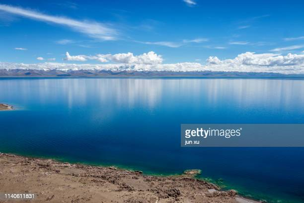 tibetan holy symbol of the sky lake on the blue sky and white clouds - india summer stock-fotos und bilder