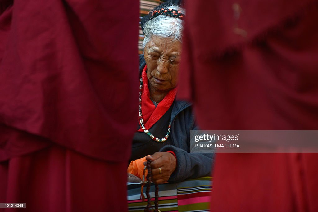A Tibetan in exile observes the third day of Losar, the Tibetan new year, in Kathmandu on February 13, 2013. A Tibetan monk doused himself in petrol in a Kathmandu restaurant on Wednesday and set himself on fire, marking the 100th self-immolation bid in a wave of protests against Chinese rule since 2009. AFP PHOTO/Prakash MATHEMA