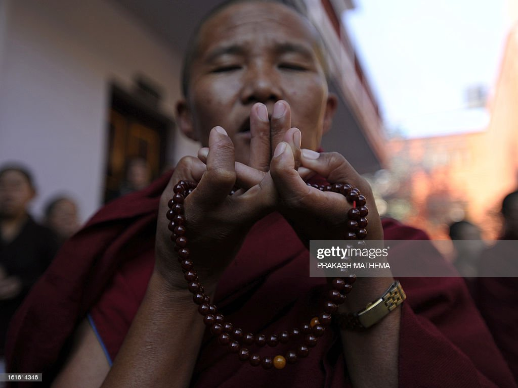 A Tibetan in exile prays on the third day of Losar, the Tibetan new year, in Kathmandu on February 13, 2013. A Tibetan monk doused himself in petrol in a Kathmandu restaurant on Wednesday and set himself on fire, marking the 100th self-immolation bid in a wave of protests against Chinese rule since 2009. AFP PHOTO/Prakash MATHEMA