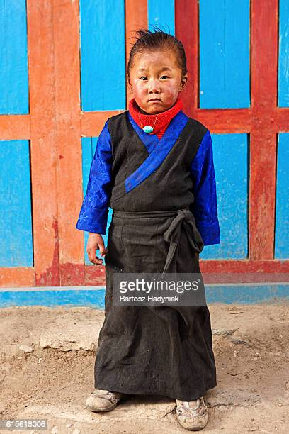 Tibetan little girl in traditional clothing. Mustang, Nepal