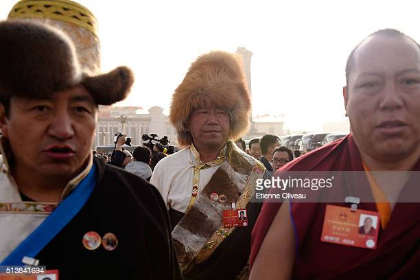 Tibetan minority delegates attend to the opening session of the China's National People's Congress on March 5 2016 in Beijing China Assembly...
