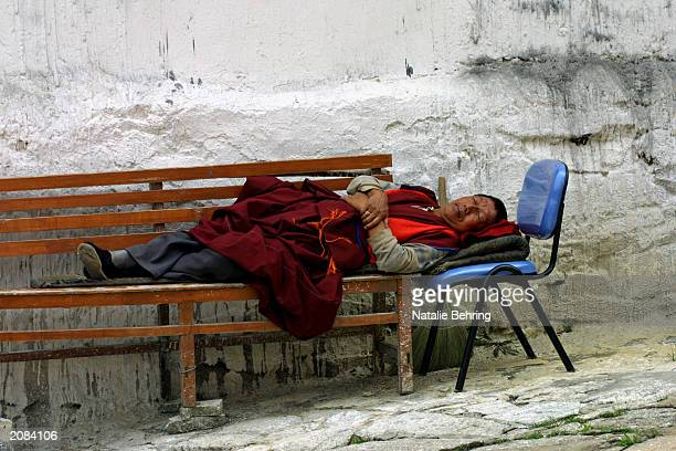 Tibetan monk, Ba Yingdelgar, takes a nap on a bench in the Wudangzhao Monastery on June 16, 2003 in Inner Mongolia, China. The 250-year-old Lamasery...