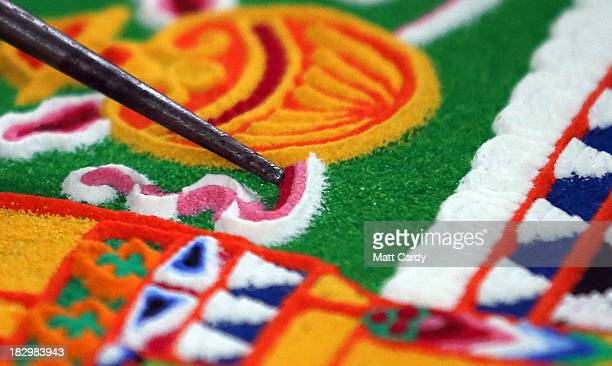 Tibetan Monk from the Tashi Lhunpo Monastery helps complete a Chenrezig Sand Mandala in Salisbury Cathedrals Chapter House on October 3 2013 in...