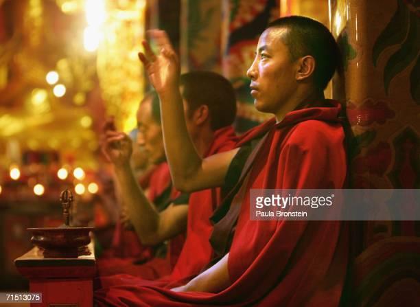 Tibetan monk prays at the Jal Gu Si Wu Min Fo Xue Yuan Tibetan monastery on July 24, 2006 in Yushu, Qinghai province, China. Around 500 monks live at...