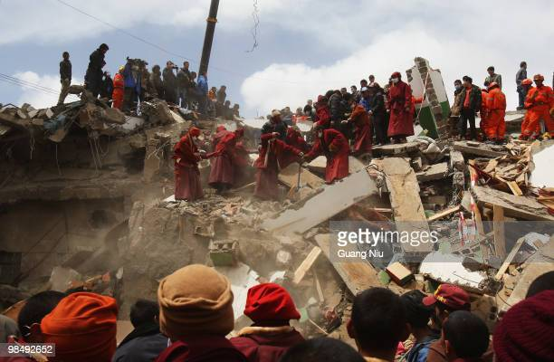 Tibetan Monks and rescue workers search through rubble following an earthquake on April 16, 2010 in Jiegu, near Golmud, China. It is currently...