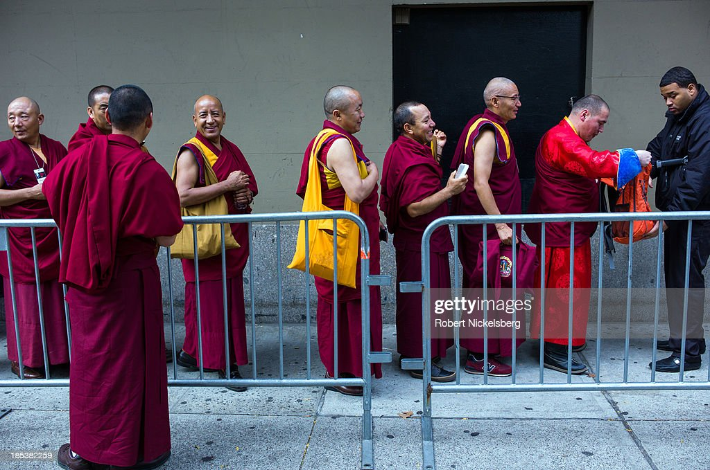 Tibetan monks attending the Dalai Lama teachings are checked by security at the Beacon Theater October 19, 2013 in New York City. The Dalai Lama is in New York for three days of Buddhist teachings supported by the Richard Gere Foundation.