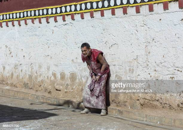 Tibetan monks enjoying a water fight after the yearly renovation of the Rongwo monastery Tongren County Longwu China on October 27 2017 in Longwu...