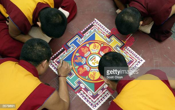Tibetan monks from the Lhunpo Monastery in southern India create a sand Mandela one piece of sand at a time at the Field Museum June 13 2003 in...