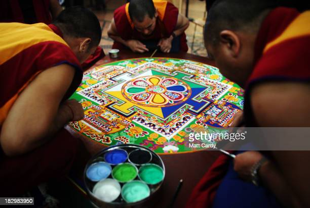 Tibetan Monks from the Tashi Lhunpo Monastery complete a Chenrezig Sand Mandala in Salisbury Cathedrals Chapter House on October 3 2013 in Salisbury...