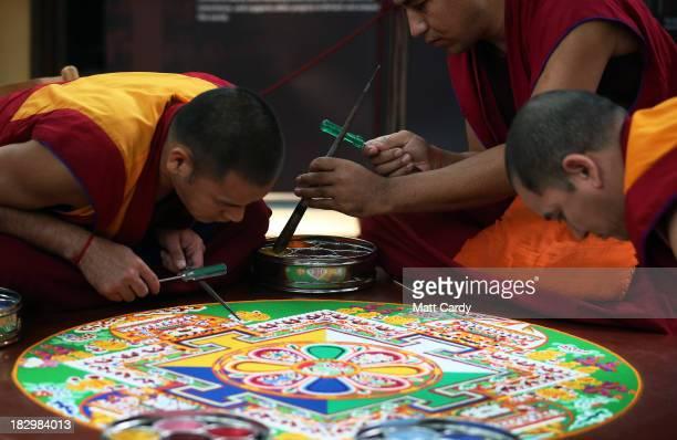 Tibetan Monks from the Tashi Lhunpo Monastery Kachen Choedrak Ven Lobzang Thokmed and Kachen Namgyal complete a Chenrezig Sand Mandala in Salisbury...
