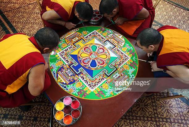 Tibetan Monks from the Tashi Lhunpo Monastery Kachen Lobzang Tuskhor Kachen Choedrak Ven Lobzang Thokmed and Kachen Namgyal complete a Chenrezig Sand...