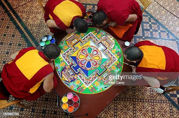 Tibetan Monks from the Tashi Lhunpo Monastery Ven Lobzang Thokmed Kachen Namgyal Kachen Lobzang Tuskhor and Kachen Choedrak complete a Chenrezig Sand...