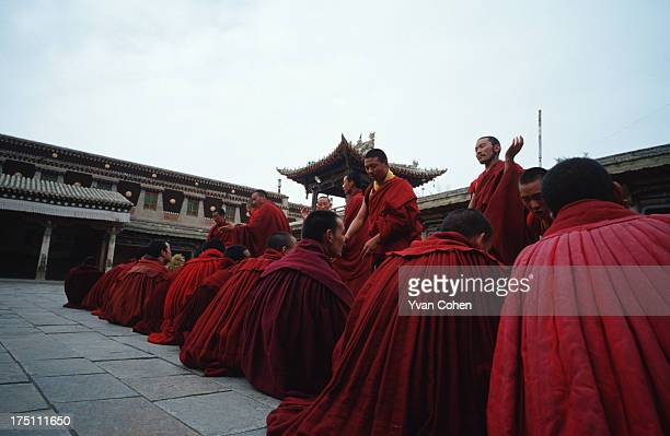 Tibetan monks involved in a ritual debating session at Kumbum monastery. Kumbum monastery was the birthplace of Je Tsongkhapa, the founder of the...