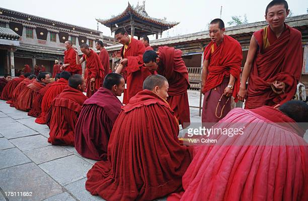 Tibetan monks involved in a ritual debating session at Kumbum monastery Kumbum monastery was the birthplace of Je Tsongkhapa the founder of the...