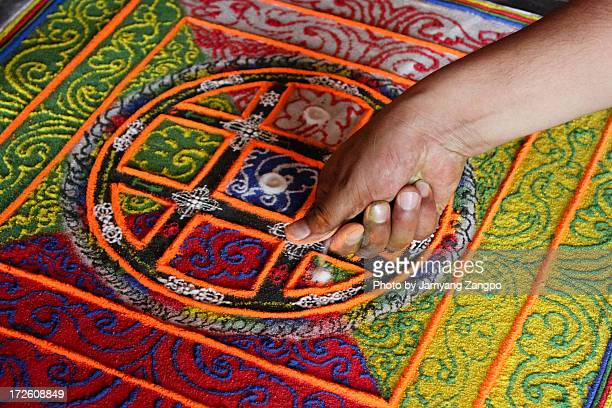 Tibetan monks making sand mandala