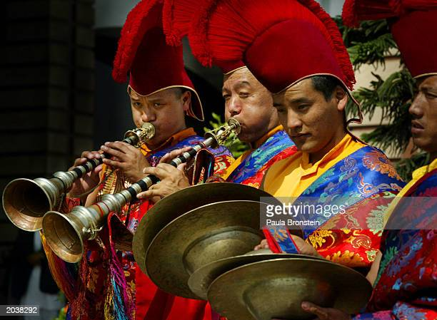 Tibetan monks perform in traditional dress before the arrival of Nepalese King Gyanendra and Nepalese Crown Prince Paras Bir Bikram Shah Dev during...