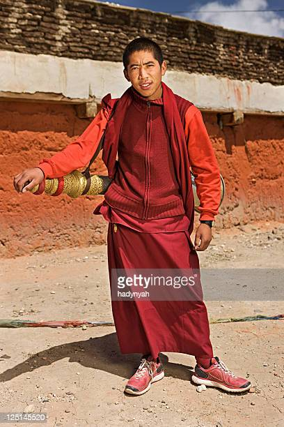 tibetan monks playing buddhist horns - lo manthang stock pictures, royalty-free photos & images