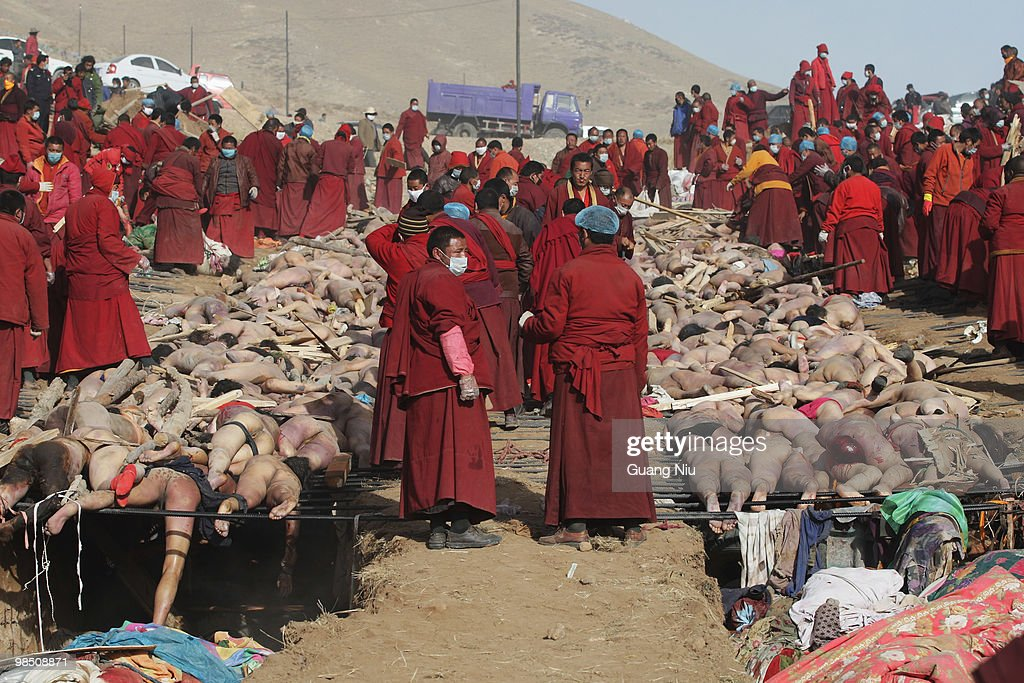 Tibetan monks prepare a mass cremation for the victims of a strong earthquake, on April 17, 2010, in Jiegu, near Golmud, China. Current reports state 1144 people died and more than eleven thousand were injured when the 7.1 magnitude earthquake struck Qinghai Province. Most of the victims are Tibetan and would normally have a sky burial, in which the bones of the bodies are broken and are left for vultures, but the sheer number of victims have forced the authorities to abandon the practice.