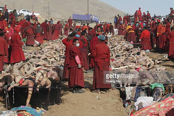 Tibetan monks prepare a mass cremation for the victims of a strong earthquake on April 17 in Jiegu near Golmud China Current reports state 1144...