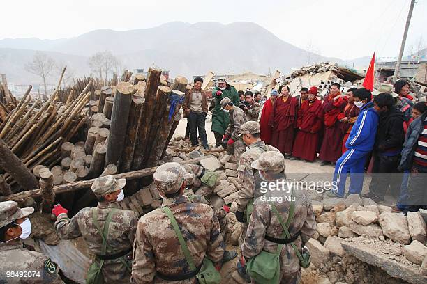 Tibetan monks, rescue workers and Chinese soldiers prepare to remove rubble following a strong earthquake, on April 16, 2010. It is currently...