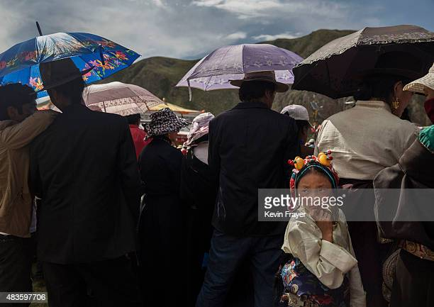 Tibetan nomad girl wears traditional clothing at a local festival on July 27 2015 on the Tibetan Plateau in Yushu County Qinghai China Tibetan nomads...