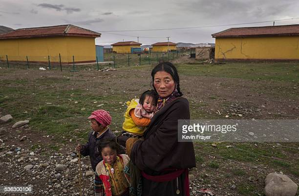 Tibetan nomad woman stands on a road on May 20 2016 in Sershul on the Tibetan Plateau in the Garze Tibetan Autonomous Prefecture of Sichuan province...