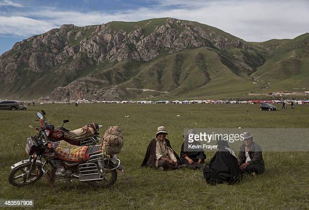 Tibetan nomads attned at a local festival on July 25 2015 on the Tibetan Plateau in Yushu County Qinghai China Tibetan nomads face many challenges to...