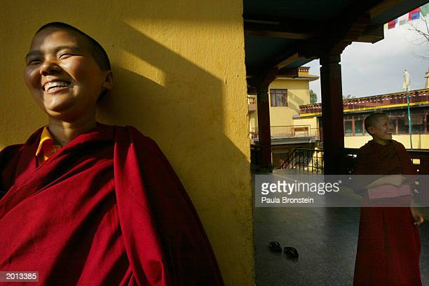 Tibetan nun smiles while taking a break from a three hour 'Puja' or prayer meditation session at the Keydong ThukChe Choling Monastery on May 19 2003...