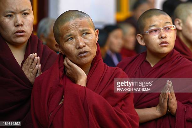 Tibetan nuns in exile observe the third day of Losar, the Tibetan new year, in Kathmandu on February 13, 2013. A Tibetan monk doused himself in...