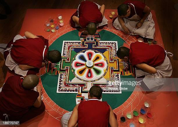 Tibetan nuns make a sand mandala at Davis Museum Wellesley College Tibetan Buddhist nuns from the KeydongThukCheCheLing Nunnery in Kathmandu Nepal...