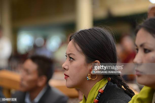 A Tibetan onlooker listens as reelected Sikyong Lobsang Sangay speaks during his swearingin at the Tsuglakhang Temple in McLeod Ganj on May 27 2016...