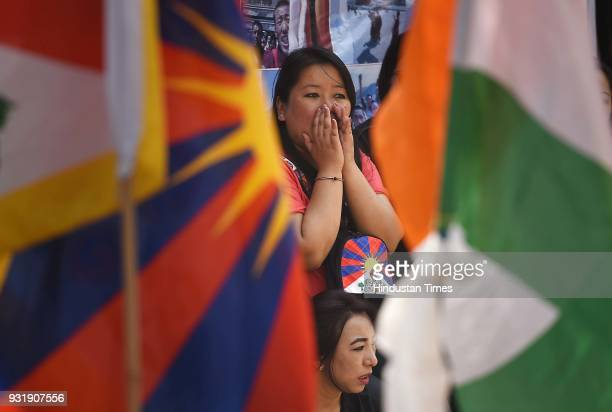 Tibetan people gather for peaceful protest against China government during the 10th Anniversary of Tibetan Uprising at Parliament Street near Jantar...