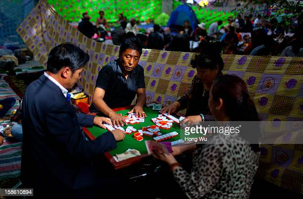Tibetan people gather to play mahjong during the Sho Dun Festival in Norbulingka on August 18 2012 in Lhasa China Lhasa is the administrative capital...