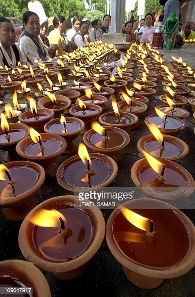 Tibetan people light dozens of oillamps and offer prayers for the late King Birendra and his family 08 June 2001 who were killed in a shooting...
