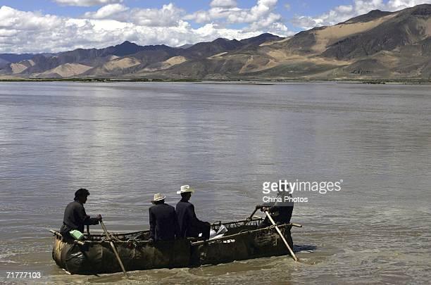 Tibetan people row a cowskin raft on the Brahmaputra River on August 30 2006 in Renbu County of Tibet Autonomous Region China Cowskin is a...