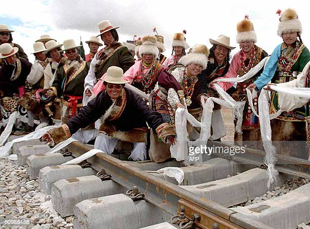 Tibetan performers celebrate on the newly laid rail tracks at Amdo Station some 440 kilometers from the capital Lhasa at the foot of the Tanggula...