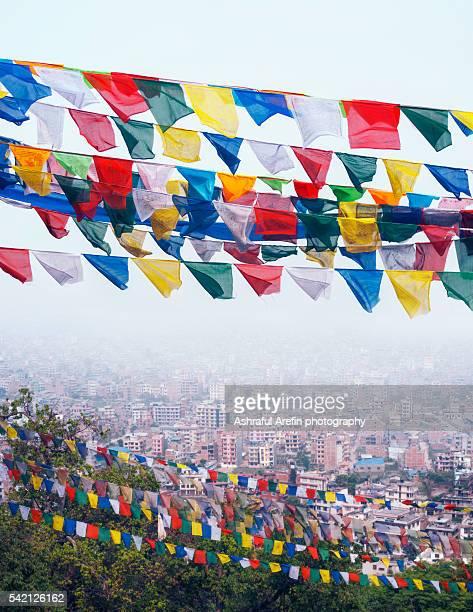 tibetan prayer flags and Kathmandu cityscape