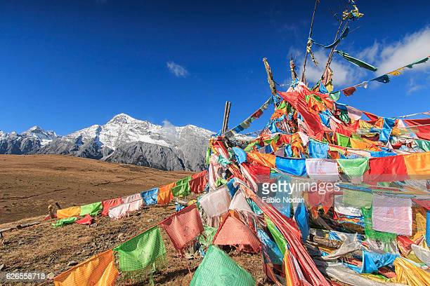 Tibetan Prayer Flags on foreground and Jade Dragon Snow Mountain on background