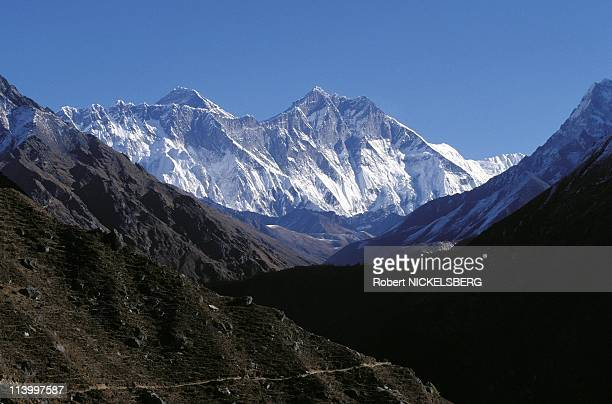 Tibetan refugees on trail from Tibet to Kathmandu or Dharamsala In Nepal In 1997-Mount Everest .