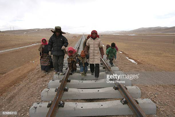 Tibetan residents walk at the construction site of the 2040km long QinghaiTibet Railway at an altitude of 4900 meters outside of Lhasa April 22 2005...