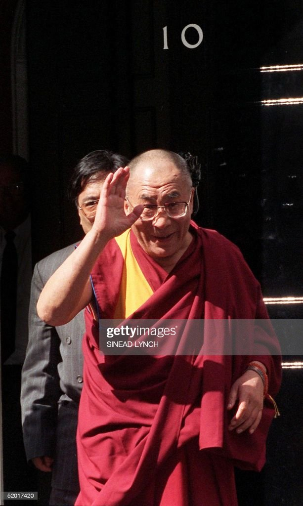 Tibetan s pritual leader the Dalai Lama waves outside no. 10 Downing St. following a meeting with British Prime Minister Tony Blair 10 May, 1999. It is the Tibetan spiritual leader's first meeting with British government leaders since Blair took office in 1997.