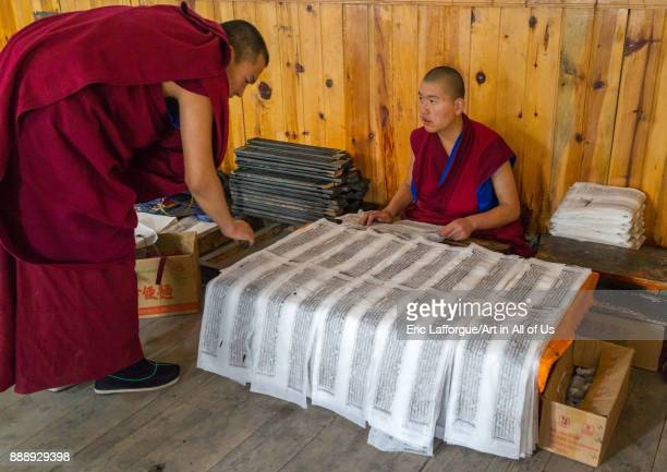 Tibetan scriptures printed from wooden blocks in the monastery traditional printing temple, Gansu province, Labrang, China on October 31, 2017 in...