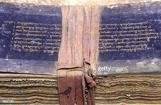 Tibetan scriptures written with golden ink on dozens of traditional papers at the Pelkor Chode monastery in the county of Gyantse in Tibetan...