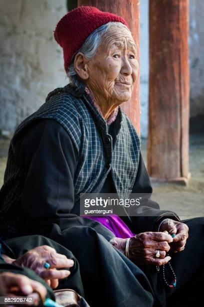 Tibetan senior woman with her buddhist prayer beads