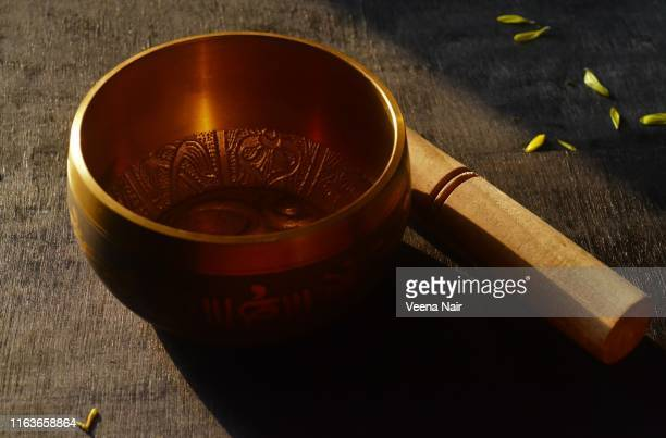 tibetan singing bowl in the morning light - gong stock pictures, royalty-free photos & images