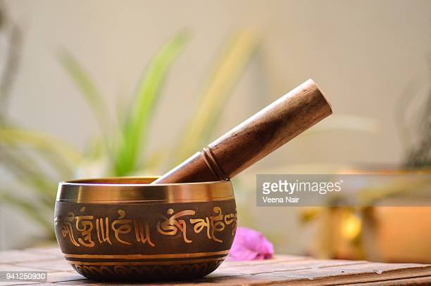 tibetan singing bowl on a wooden table/ahmedabad - gong stock photos and pictures